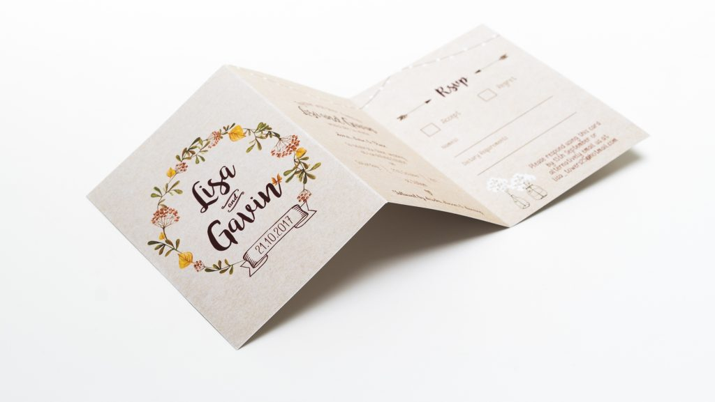 Trifold wedding invites and rsvp card on kraft paper